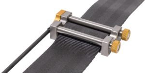 Load cell that measures the force on the seat belt webbing.